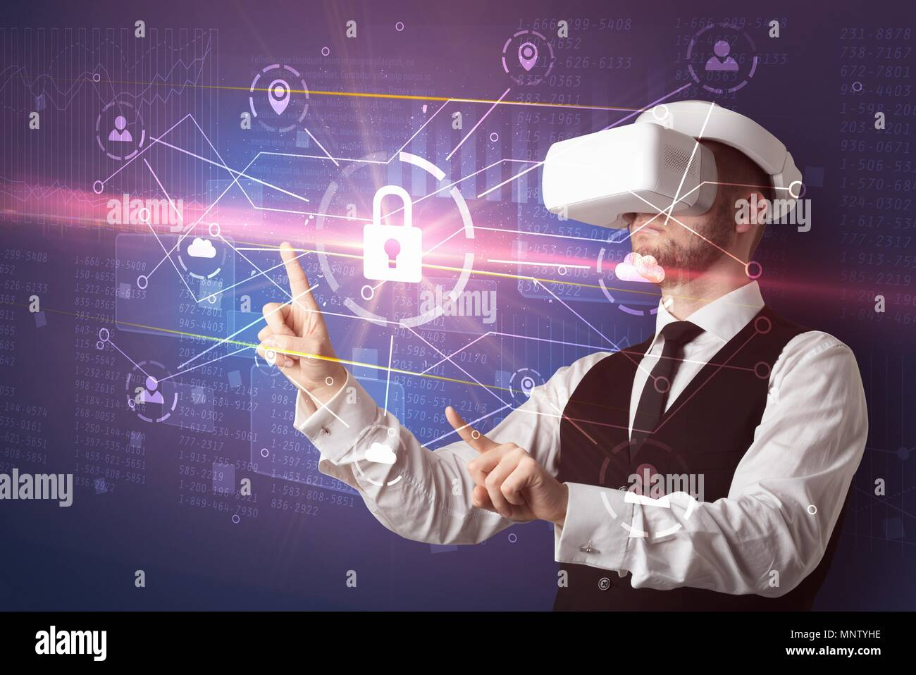 Businessman with DJI goggles controlling 3D illustrated network, and series on the background  - Stock Image