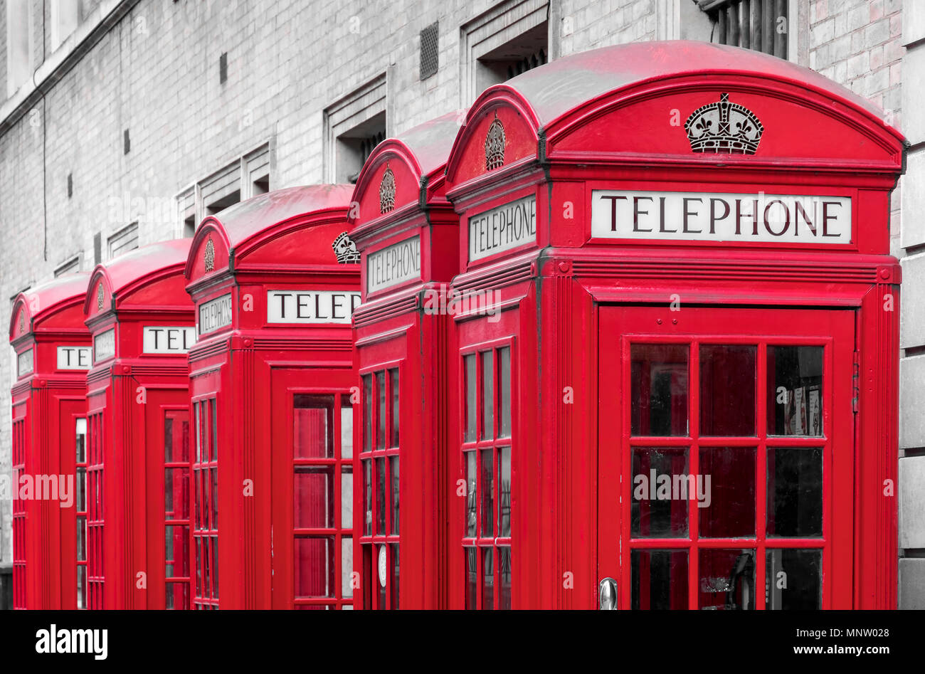 A Row of Red British Telephone Boxes, London, England, UK - Stock Image