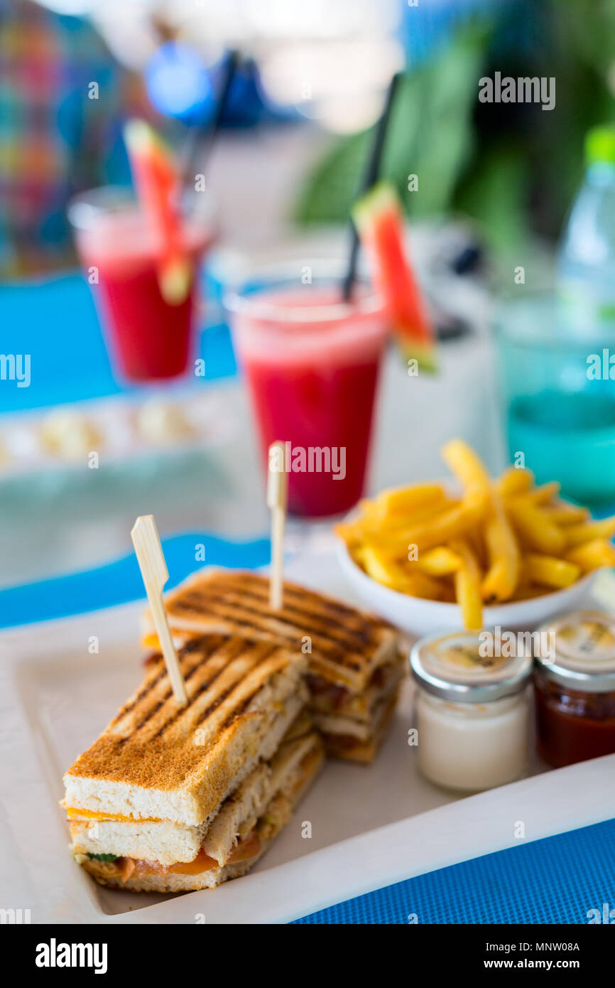 Delicious fresh chicken sandwich and french fries served for lunch - Stock Image