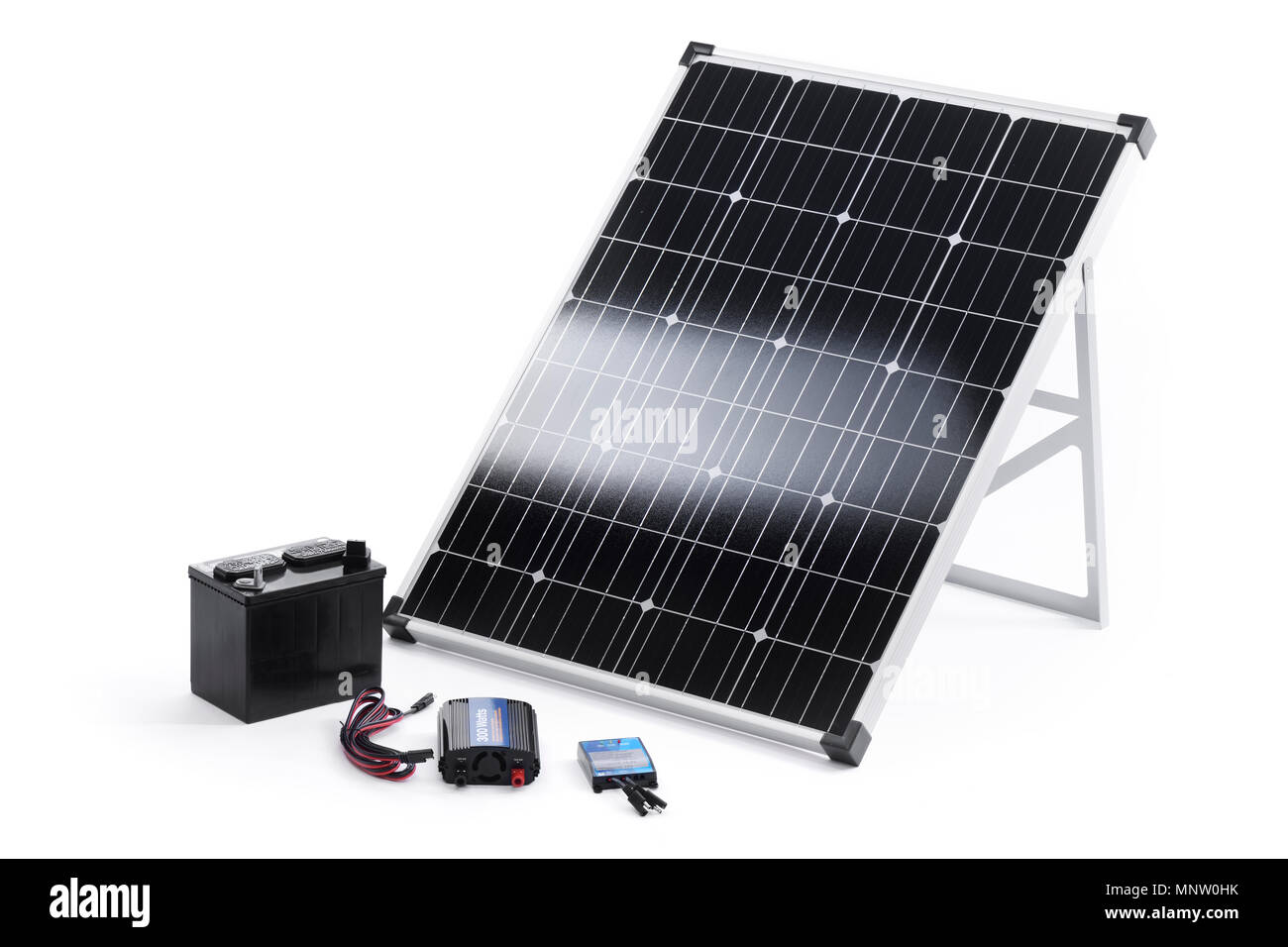 Solar power kit with a portable 100 Watt crystalline solar panel, inverter, charge controller and a battery isolated on white background - Stock Image