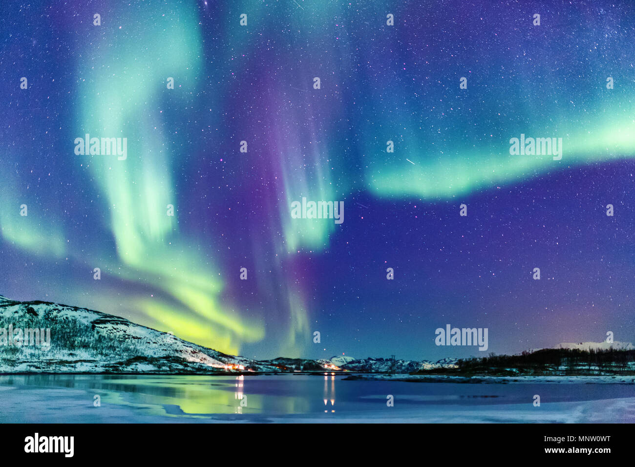 Incredible Northern lights Aurora Borealis activity above the coast in Norway - Stock Image
