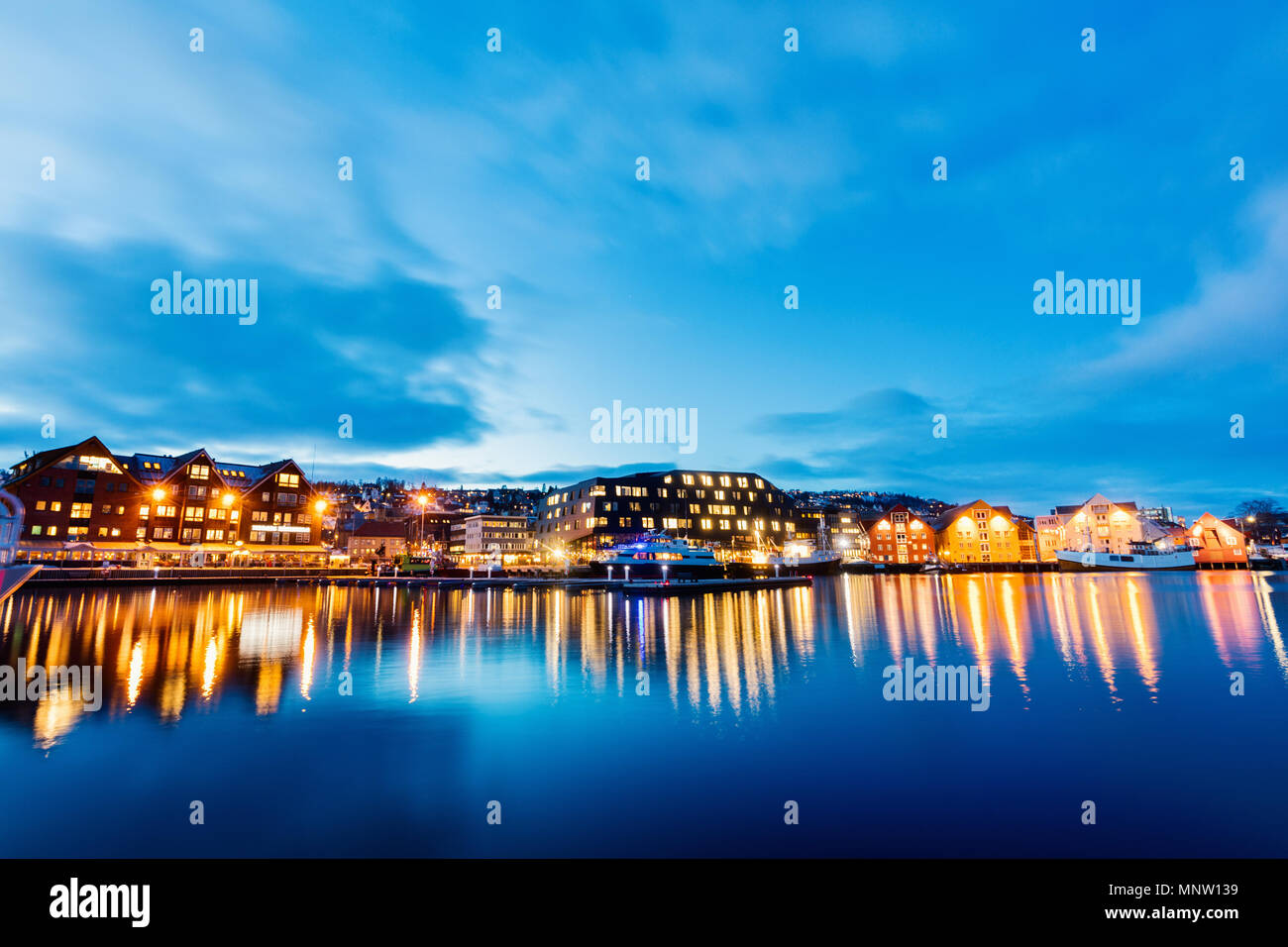 Beautiful town of Tromso in Northern Norway at dusk twilight - Stock Image