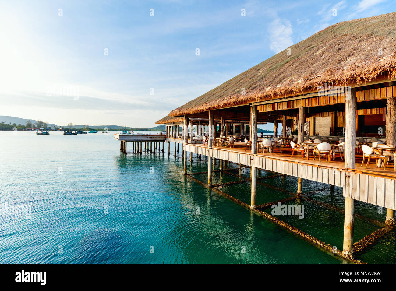 Tropical overwater bar in a luxury resort - Stock Image