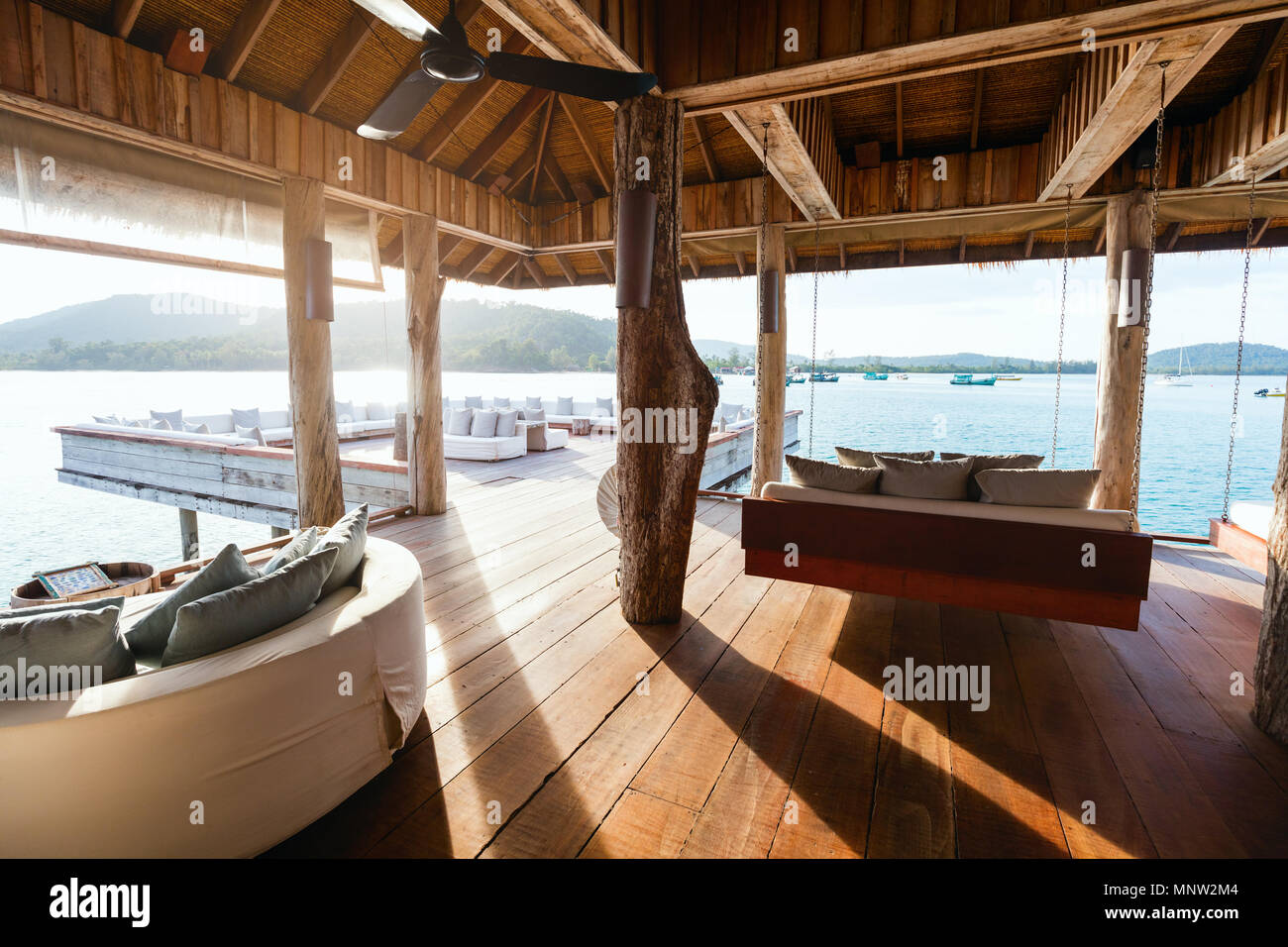 Interior of tropical overwater bar in a luxury resort Stock Photo