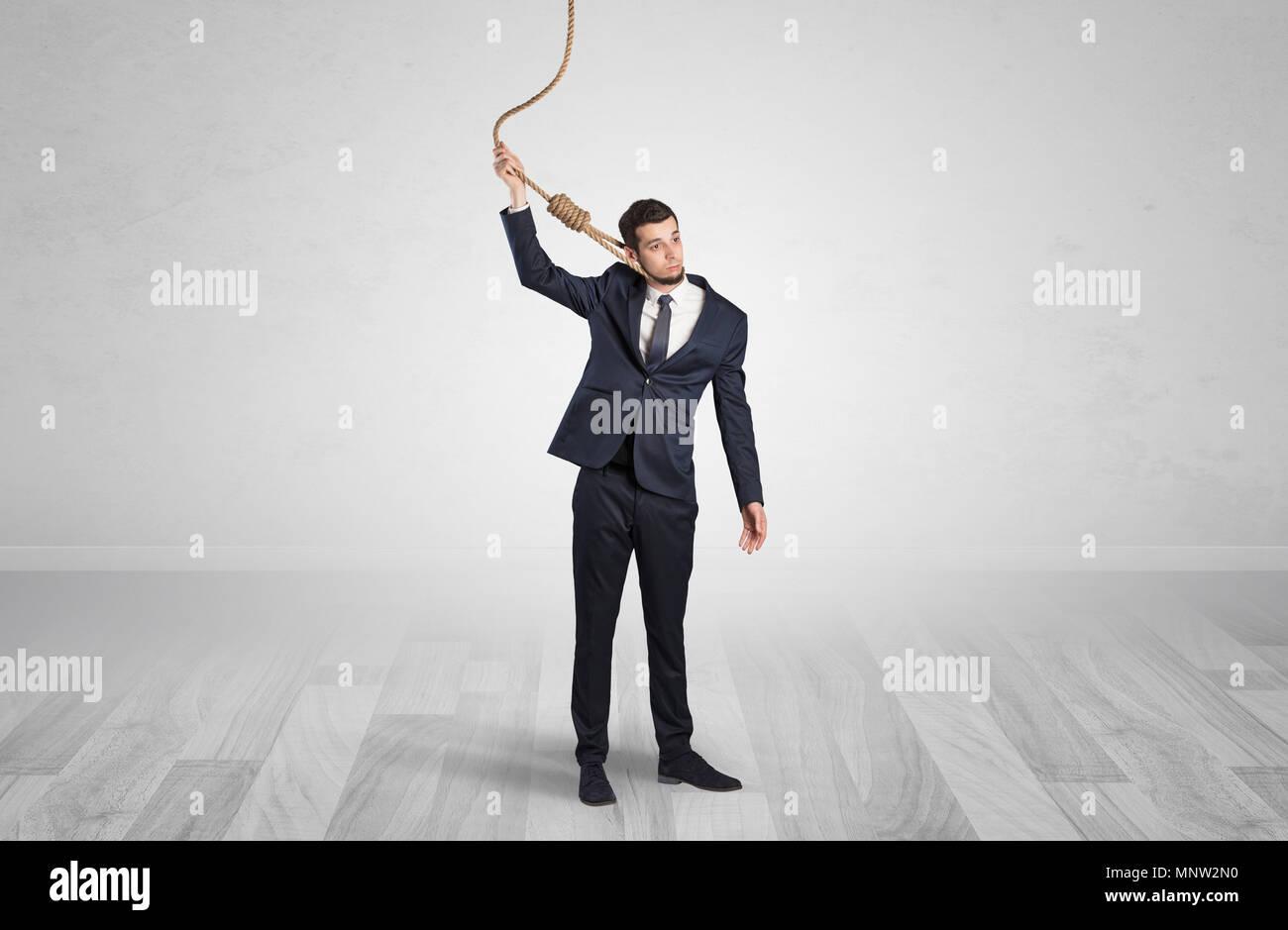 Young responsable man on the verge of suicide  - Stock Image