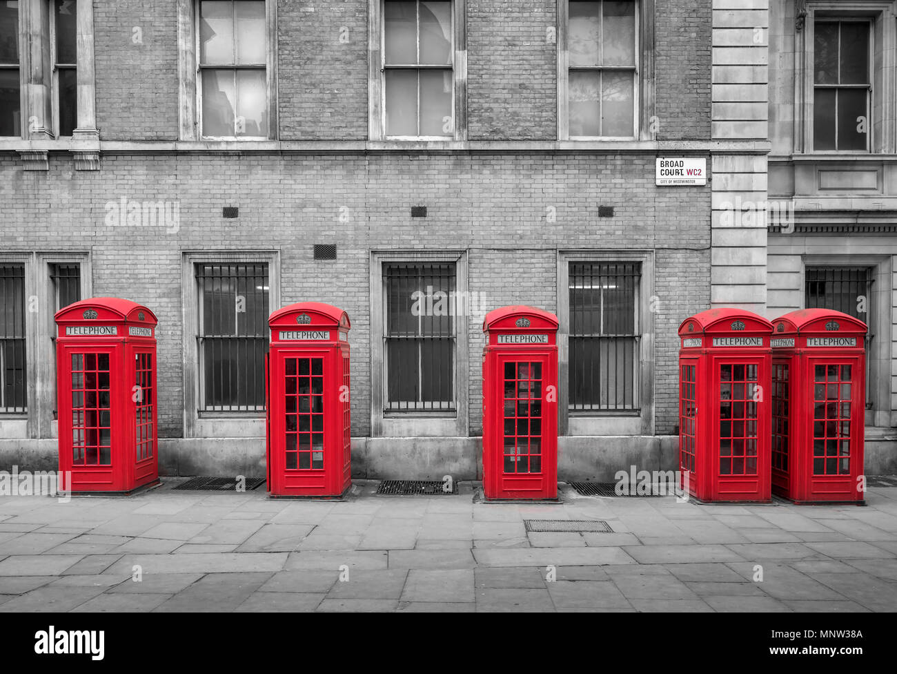 A row of British Red Telephone Boxes, Broad Court, Covent Garden, London, England, UK - Stock Image