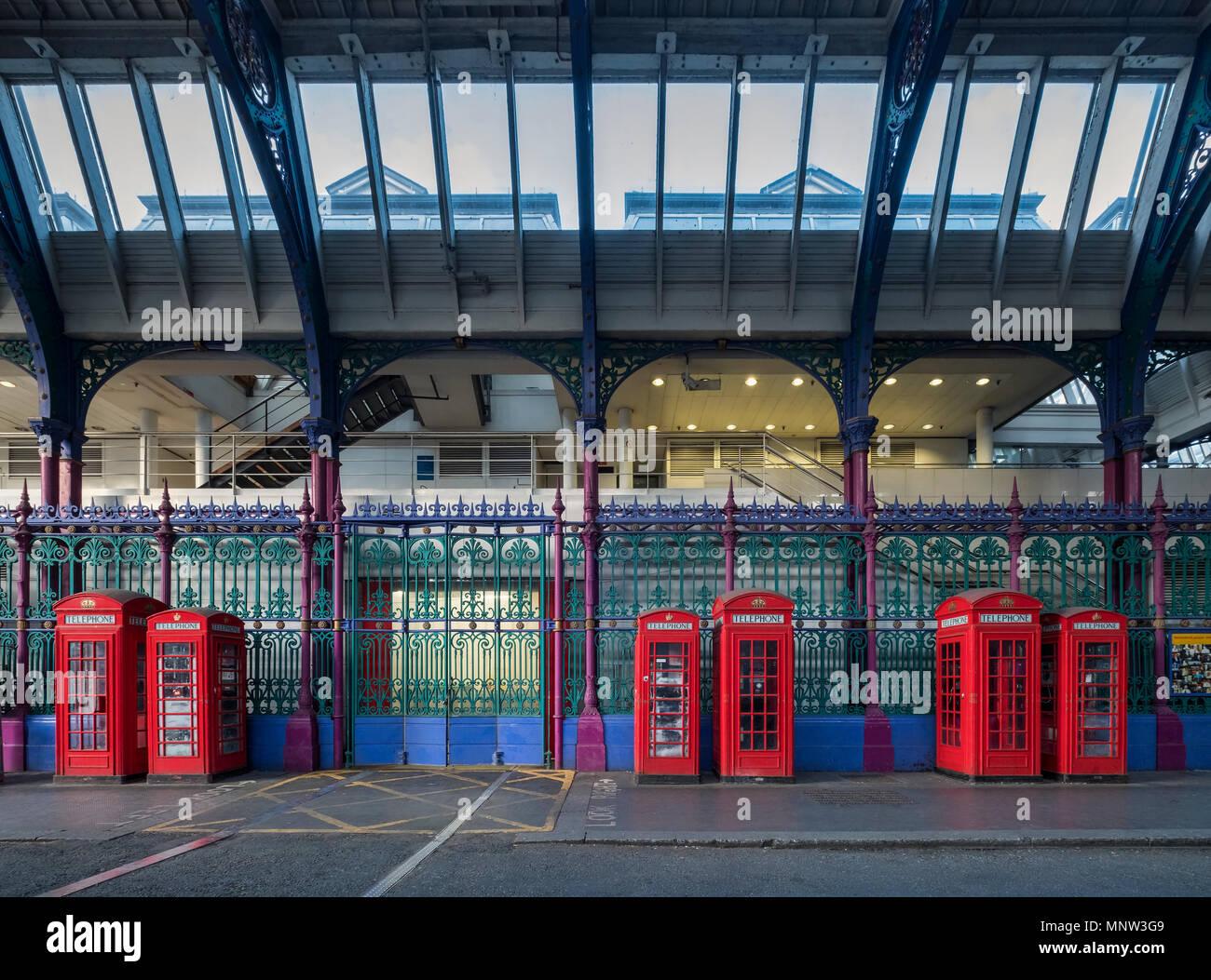 British Red Telephone Boxes at Smithfield Market, London, England, UK - Stock Image