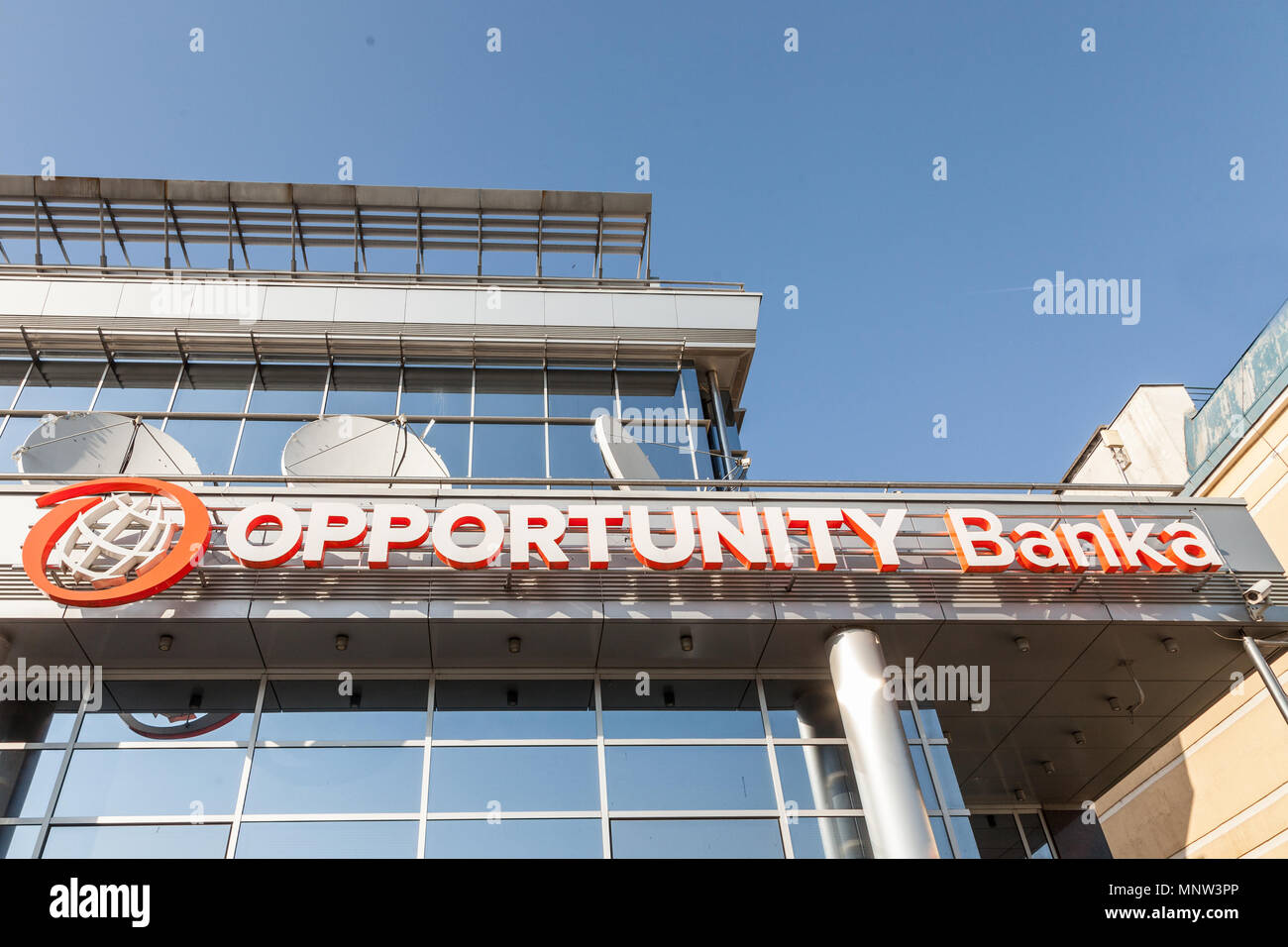 BELGRADE, SERBIA - APRIL 29, 2018: Logo of Opportunity Bank on their local headquarters for Serbia. Opportunity International is an NGo specialized in - Stock Image