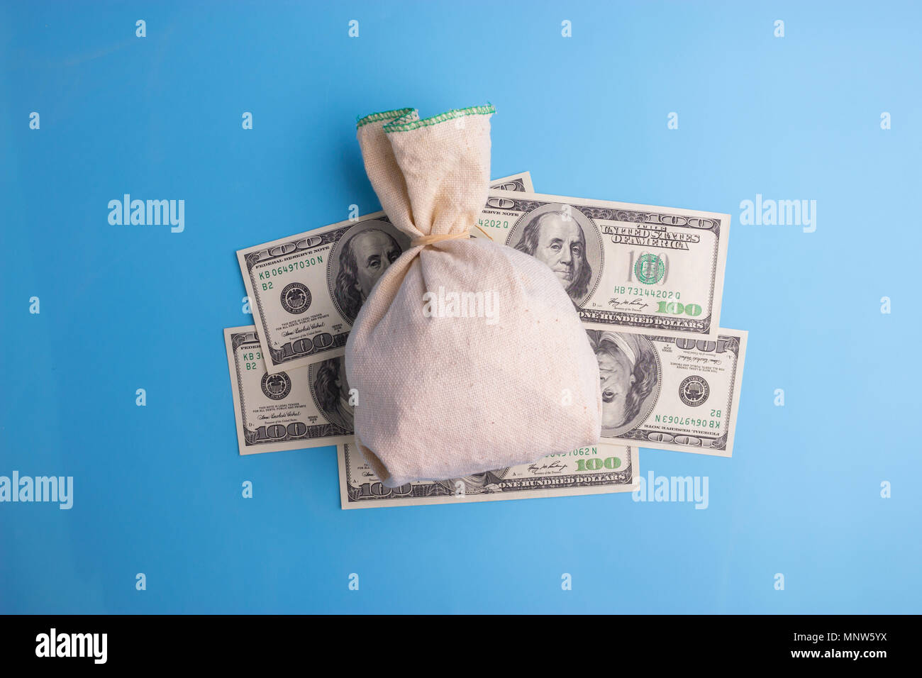 Money Bag, Currency, Paper Currency on blue background - Stock Image