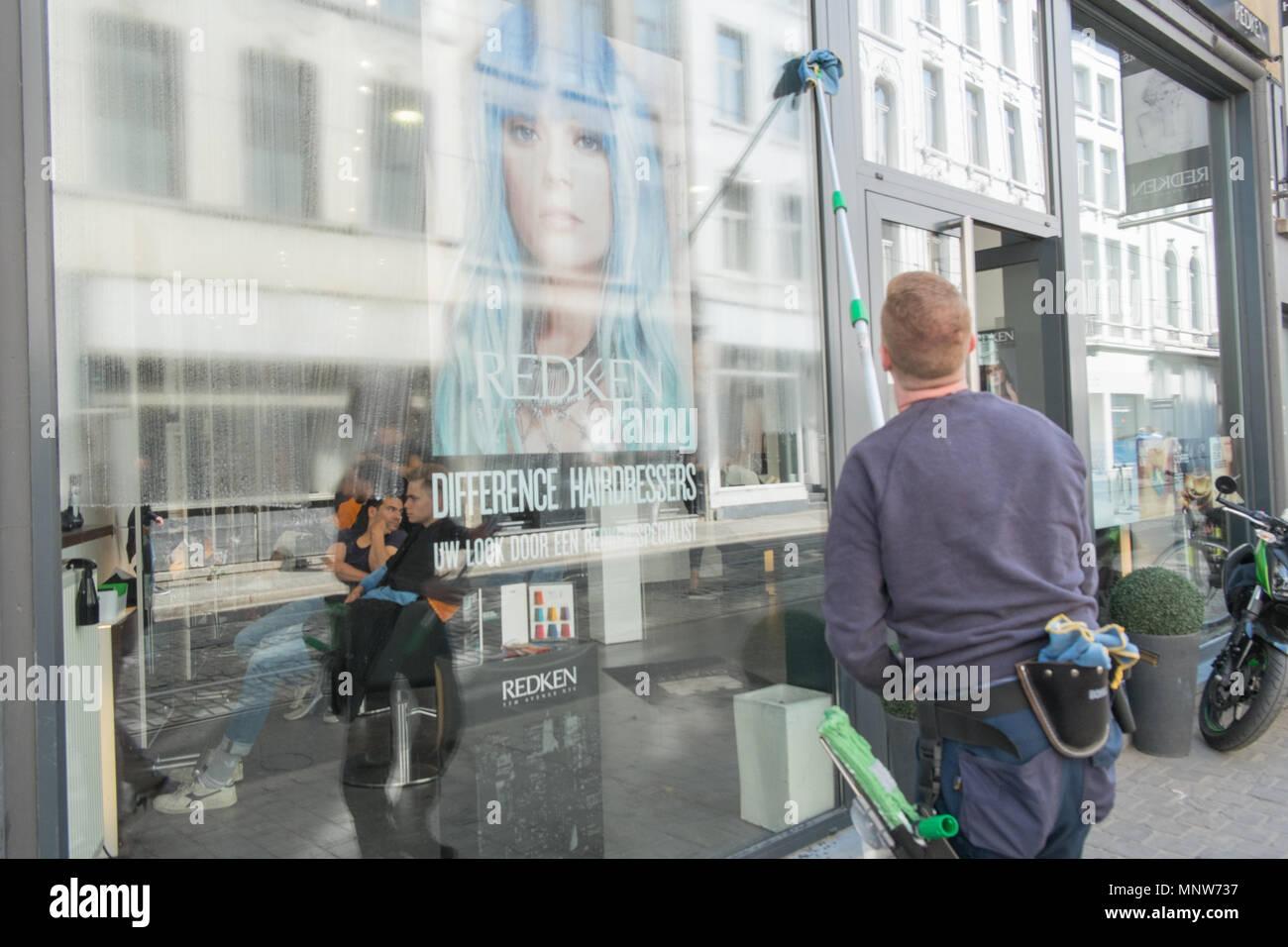 window cleaner washing windows in antwerp, belgium Stock Photo