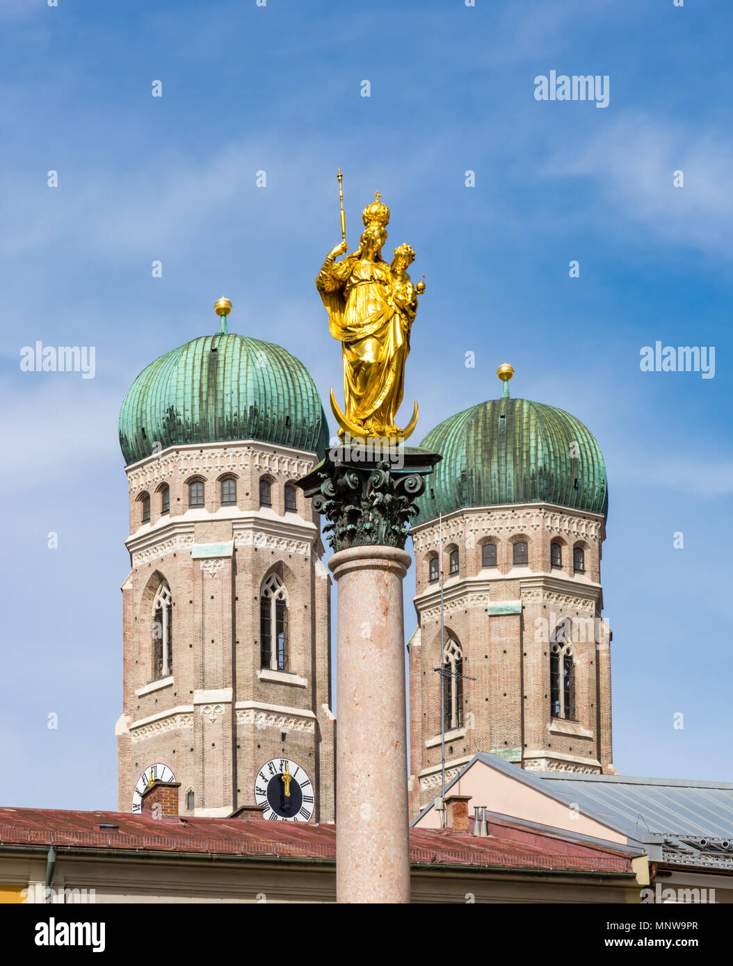 Marian column and the Frauenkirche cathedral of Munich - Stock Image