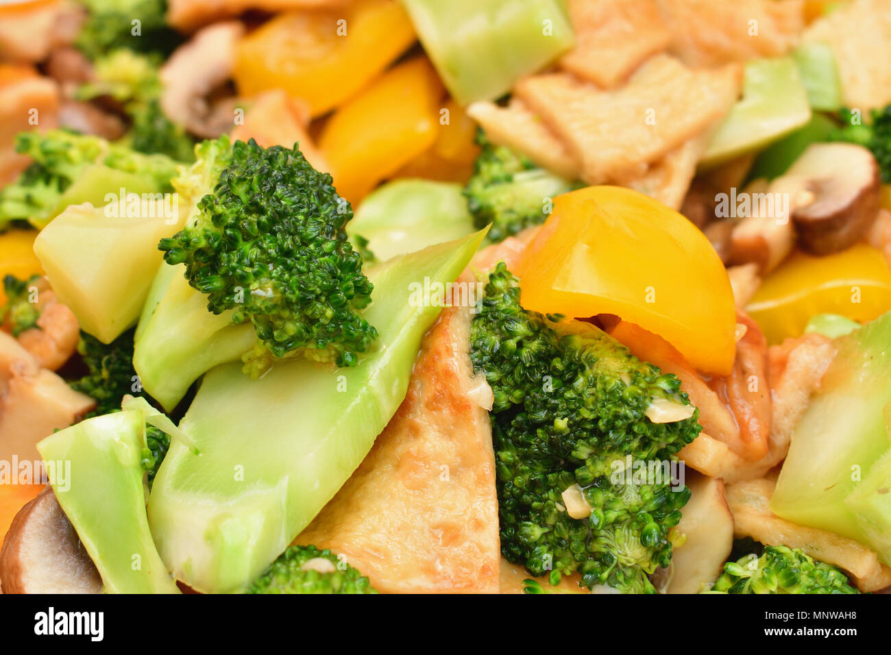 A Chinese dish of mixed vegetables including sliced broccoli, sliced capsicum, sliced mushrooms and beancurd skin. Stock Photo