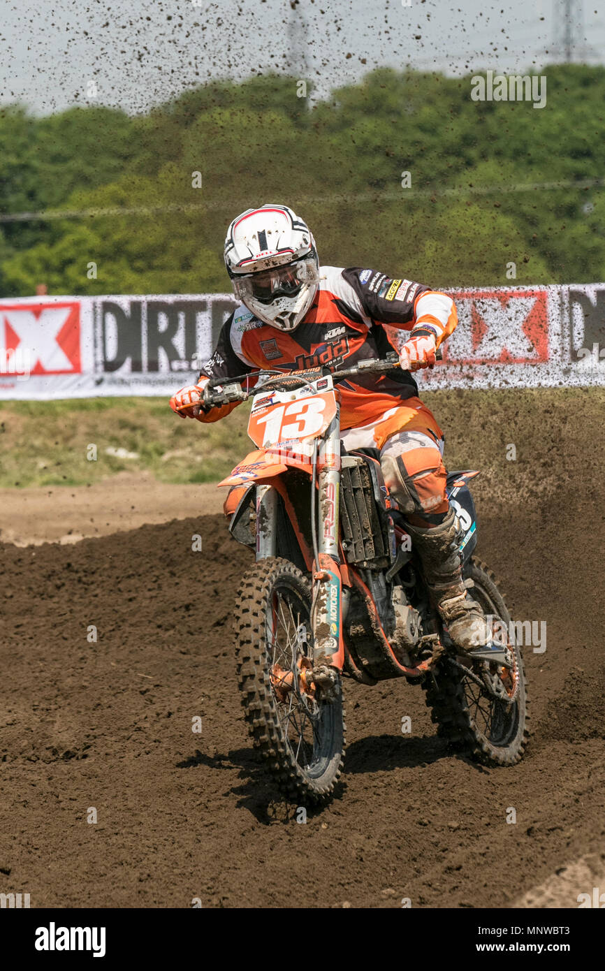 Preston, UK. 19/05/2018.  Michelin MX Nationals moto cross,  race, sport, motorcycle, speed, bike, competition, motor, extreme, motorbike, rider, transportation, power, cycle, jump, riding, danger, racer,  outdoor, fast, motorsport, biker, fun, offroad, transport, dangerous, event in dockland. Motocross by RHL Activities Ltd at Preston Docks British Championships.   Credit: MediaWorldImages/AlamyLiveNews - Stock Image