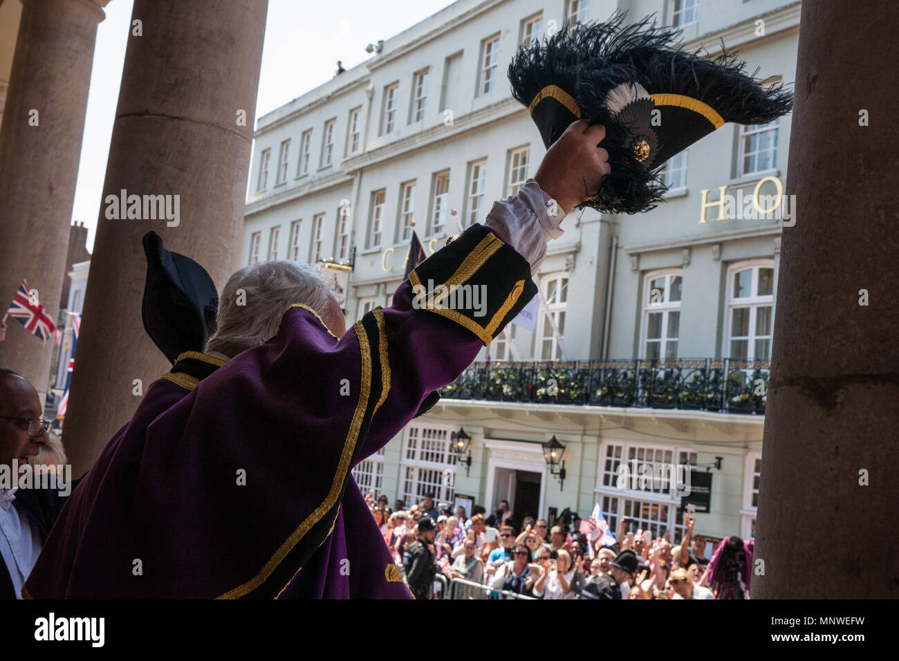 Windsor, UK. 19th May, 2018. Chris Brown, Official Town Crier of the Royal Borough of Windsor and Maidenhead, proclaims the wedding of Prince Harry and Meghan Markle at the Guildhall prior to the carriage procession. Credit: Mark Kerrison/Alamy Live News - Stock Image