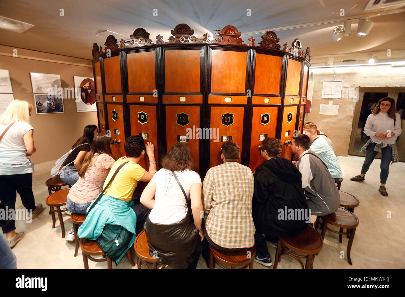 Belgrade, Serbia.  19th May, 2018. Visitors try out old movie watching device during The Night of the Museums cultural event in Belgrade, Serbia on May 19, 2018. Credit: Predrag Milosavljevic/Xinhua/Alamy Live News - Stock Image