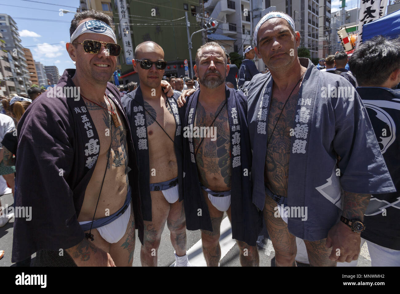 Tokyo, Japan. 20th May 2018. Participants showing their full body tattooed, pose for the cameras during the Sanja Matsuri in Asakusa district. The Sanja Matsuri is one of the largest Shinto festivals in Tokyo, and it is held in Tokyo's Asakusa district for three days around the third weekend of May. Large groups of people dressed up traditional clothes carry Mikoshi (sacred portable shrines) between the streets near to Sensoji Temple to bring blessing and fortune to the inhabitants of the neighboring community at Asakusa during the second and third day of the festival. Credit: ZUMA Press, Inc - Stock Image