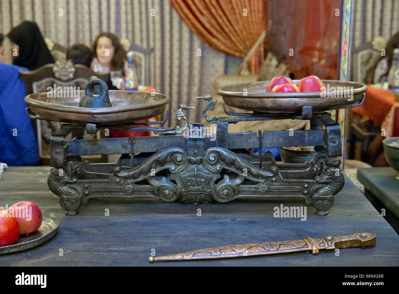 Old Antique weight measuring and kitchen goods weighing on the wooden table - Stock Image