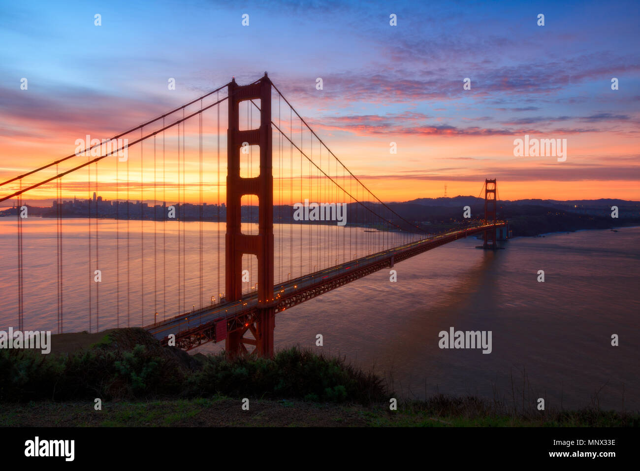 The iconic Golden Gate Bridge during a beautiful sunrise. - Stock Image