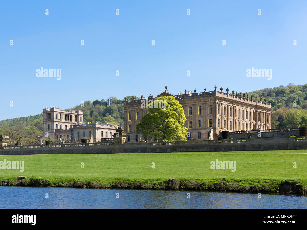 Chatsworth House from the banks of the River Derwent, Chatsworth Park, Derbyshire, England, UK - Stock Image