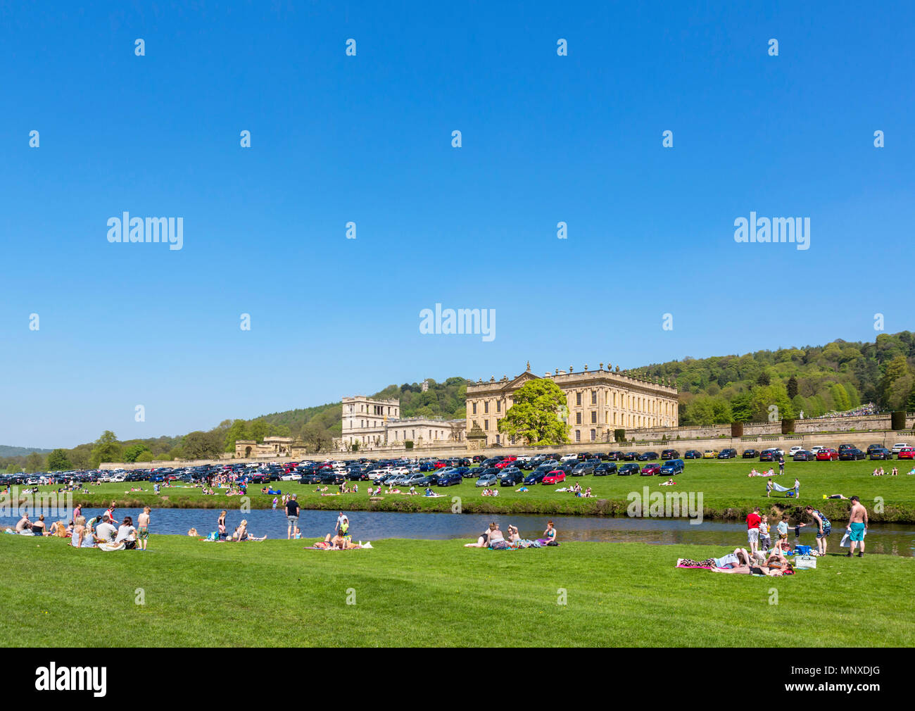 Crowds of visitors at Chatsworth Park on a busy May bank holiday weekend in 2018, Chatsworth House,  Derbyshire, England, UK - Stock Image