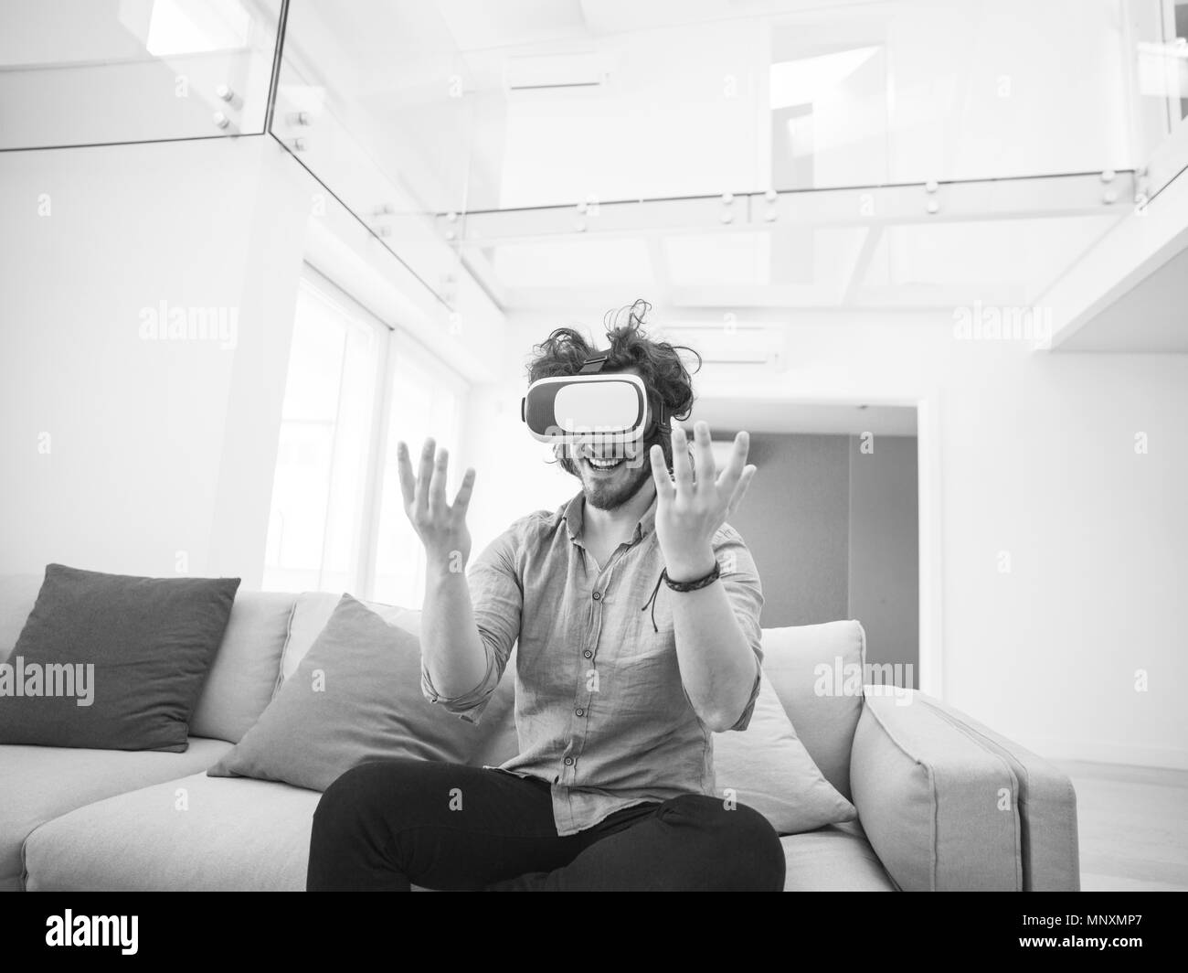 happy man getting experience using VR headset glasses of