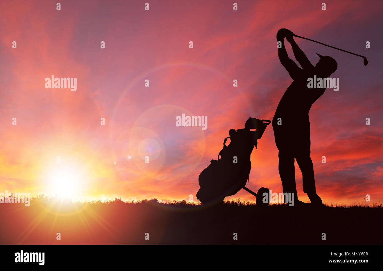 Silhouette of golfer with golf bag by his side swinging club toward sunset with deliberate lens flare and copy space. - Stock Image