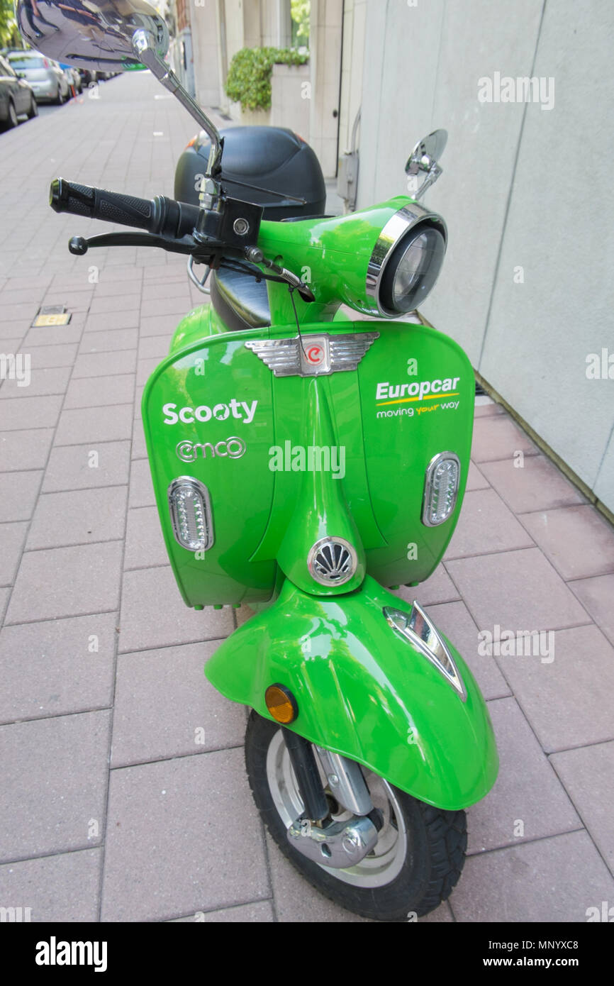 Green sharing scooter from scooty in antwerp, belgium Stock Photo