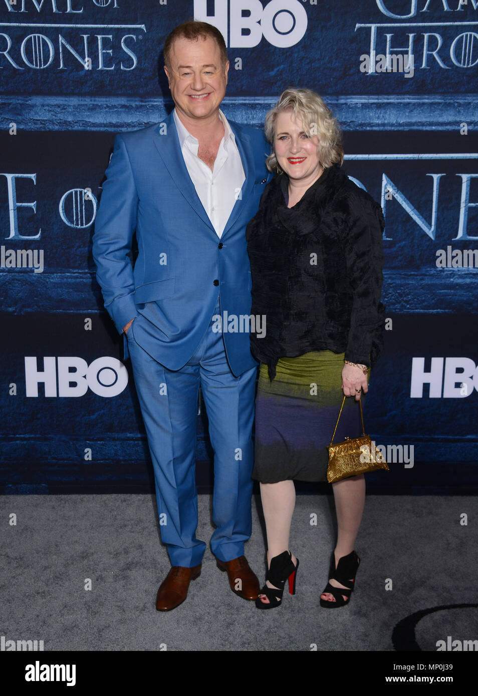 Owen Teale 330 arriving at the Game of Thrones at the TCL Chinese Theatre in Los Angeles. April 10, 2016.Owen Teale 330 ------------- Red Carpet Event, Vertical, USA, Film Industry, Celebrities,  Photography, Bestof, Arts Culture and Entertainment, Topix Celebrities fashion /  Vertical, Best of, Event in Hollywood Life - California,  Red Carpet and backstage, USA, Film Industry, Celebrities,  movie celebrities, TV celebrities, Music celebrities, Photography, Bestof, Arts Culture and Entertainment,  Topix, vertical,  family from from the year , 2016, inquiry tsuni@Gamma-USA.com Husband and wife - Stock Image