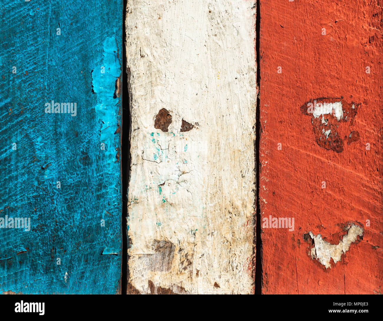 French flag made of painted wood planks. Grungy texture or background. - Stock Image