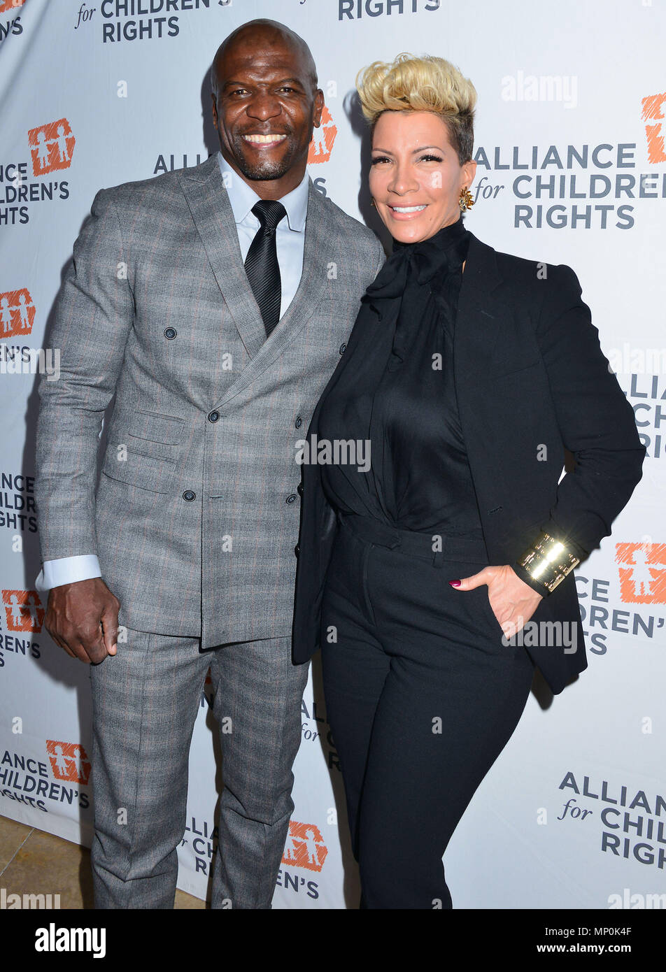 Terry Crews and wife arriving The Alliance for ChildrenÕs RightsÕ 24th Annual Dinner at the Beverly Hilton Hotel in Los Angeles. March 10, 2016.Terry Crews and wife ------------- Red Carpet Event, Vertical, USA, Film Industry, Celebrities,  Photography, Bestof, Arts Culture and Entertainment, Topix Celebrities fashion /  Vertical, Best of, Event in Hollywood Life - California,  Red Carpet and backstage, USA, Film Industry, Celebrities,  movie celebrities, TV celebrities, Music celebrities, Photography, Bestof, Arts Culture and Entertainment,  Topix, vertical,  family from from the year , 2016, - Stock Image
