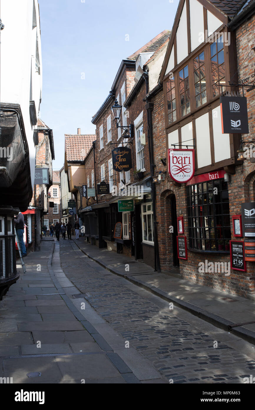 The Shambles, York, England, UK. A narrow, medieval shopping street in the city of York. - Stock Image