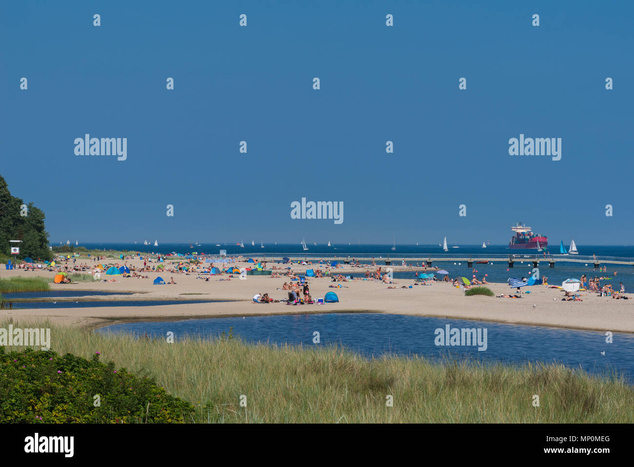 Relaxing on a hot summer day at the beach 'Falkensteiner Strand', Kiel Fjord, Kiel, Germany, - Stock Image