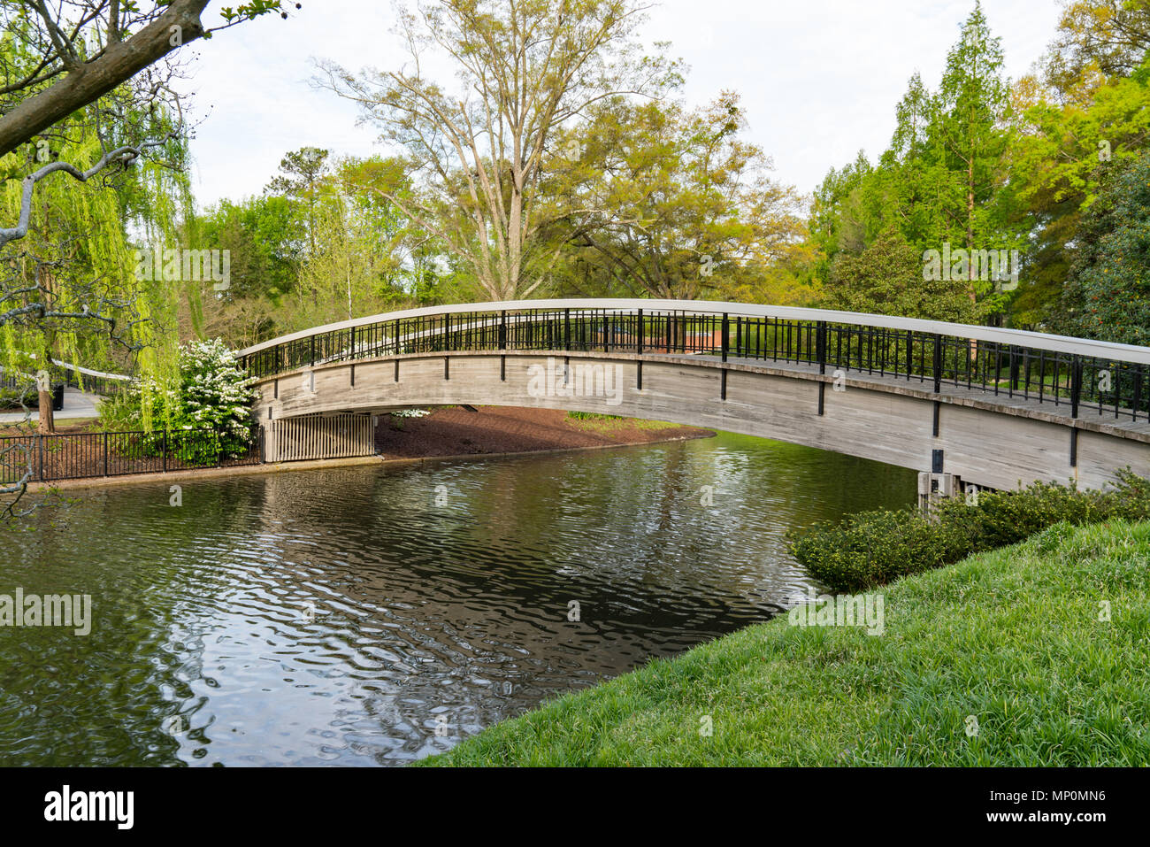 Bridge Over Lake in Pullen Park in Raleigh, North Carolina - Stock Image
