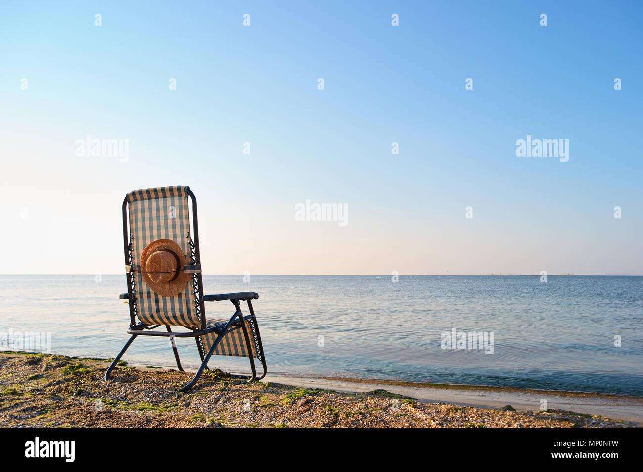 Back view deskchair in morning sea landscape. - Stock Image