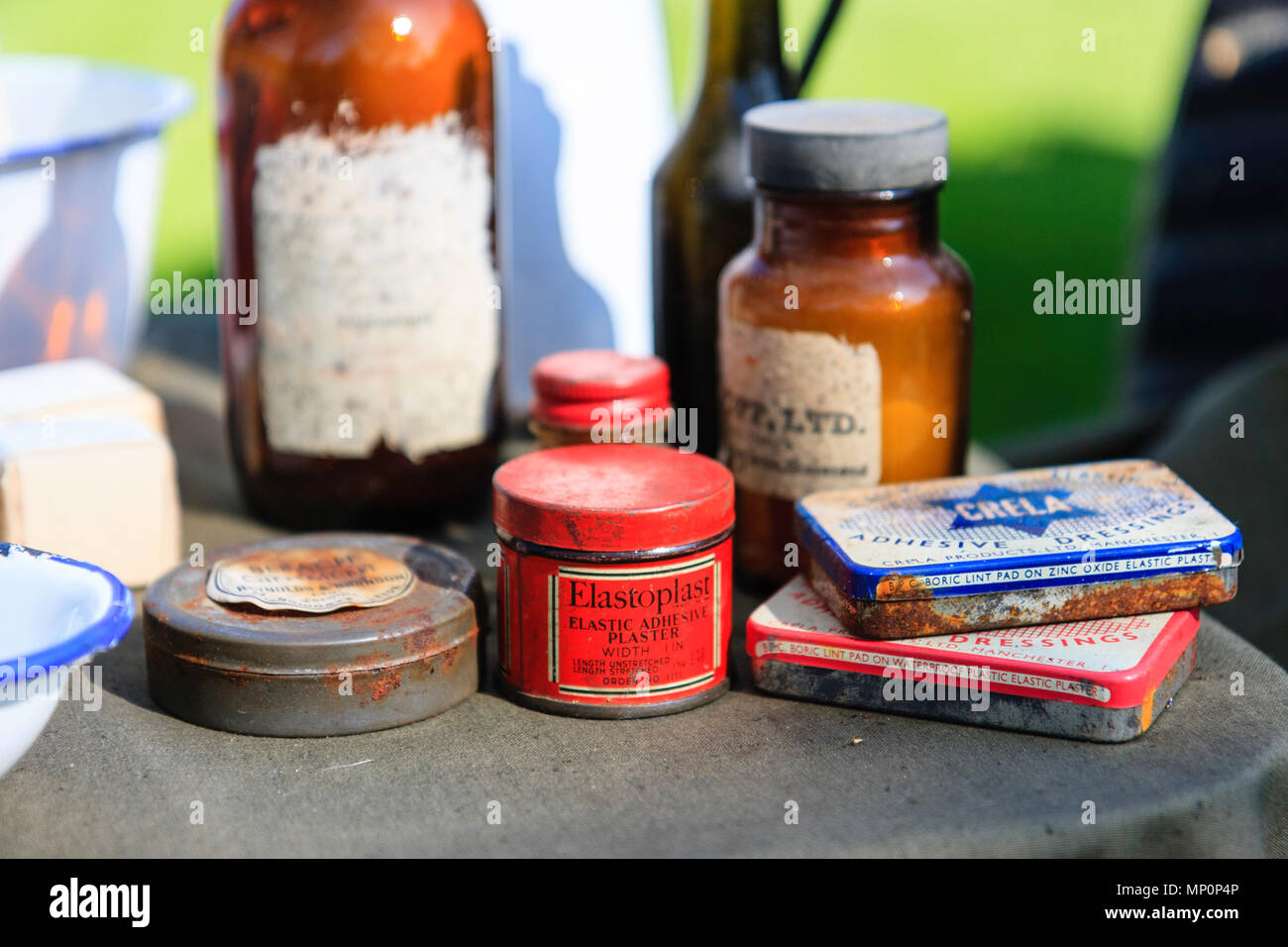 Various World war two medical items set out on a table, elastoplast plasters, tinned lint pads, other items. Narrow focus. - Stock Image