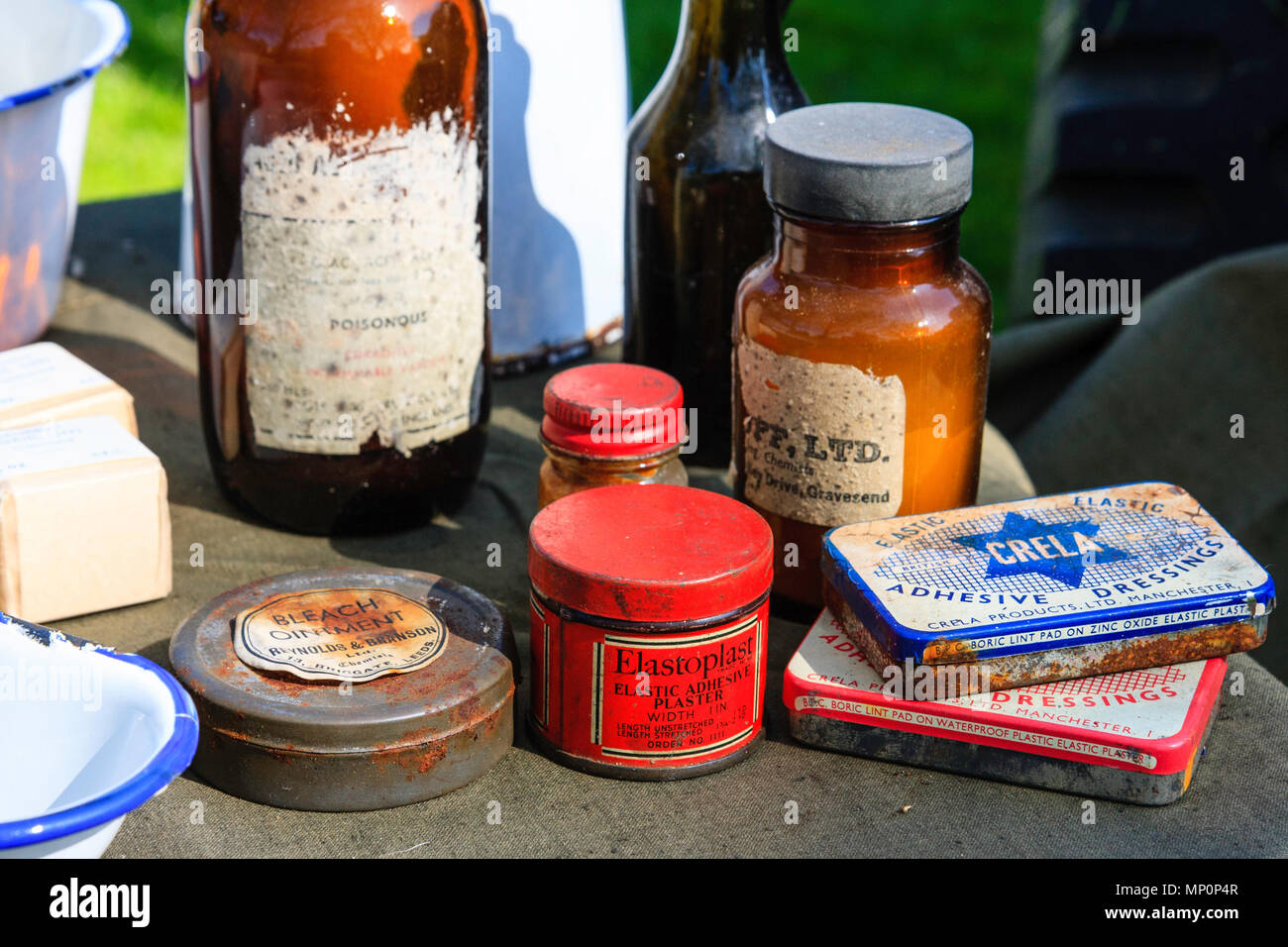 Various World war two medical items set out on a table, elastoplast plasters, tinned lint pads, other items. - Stock Image
