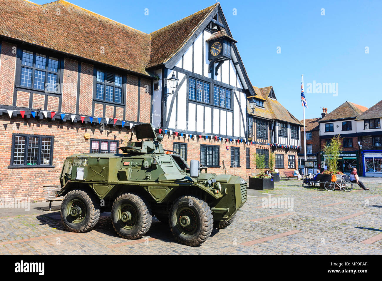 Saracen FV603 Alvis British armoured Personnel carrier parked outside the 14th century Sandwich guildhall. Daytime. - Stock Image
