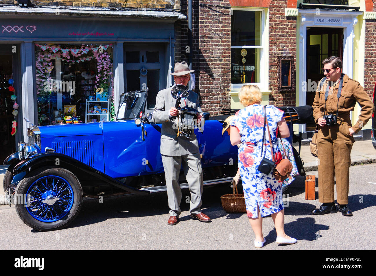 Salute to the 40s popular event at Sandwich in Kent. Man reenactor dressed as photo journalist with Graflex Speed graphic camera. - Stock Image