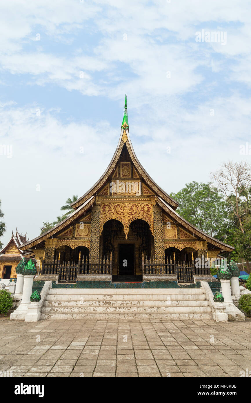 Front view of the Buddhist Wat Xieng Thong temple ('Temple of the Golden City') in Luang Prabang, Laos. - Stock Image