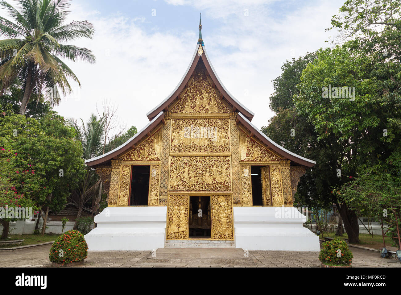 Front view of the ornate Funeral chapel at the Wat Xieng Thong temple ('Temple of the Golden City') in Luang Prabang, Laos. - Stock Image