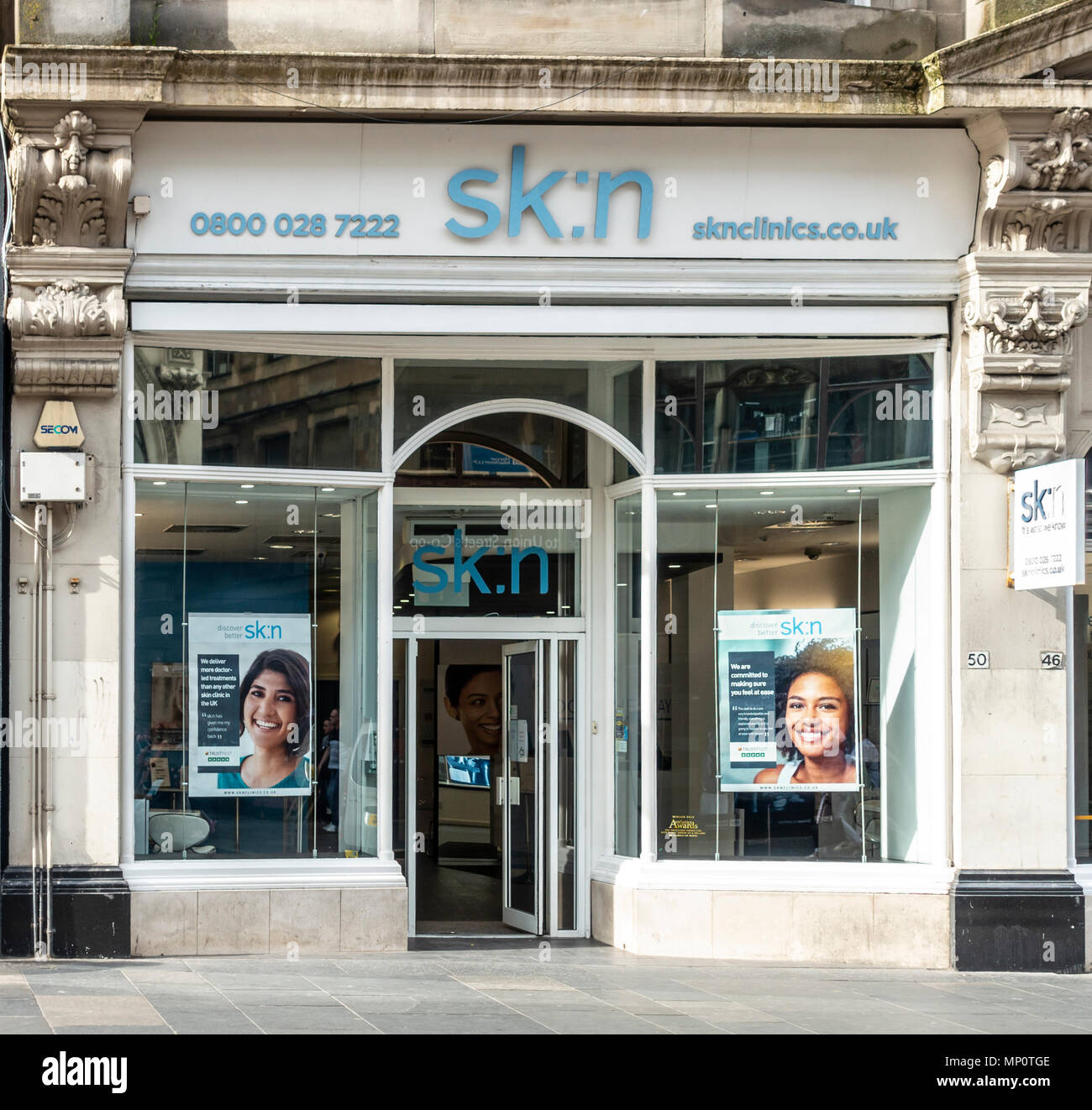 Shop frontage and entrance to the Sk:n clinic in central Glasgow, Scotland, UK - Stock Image