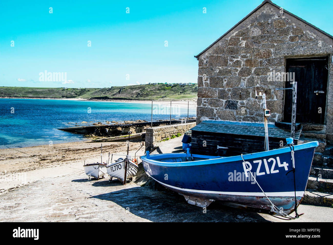 Fishing boats along the harbour of Sennen Cove, Cornwall, UK - Stock Image