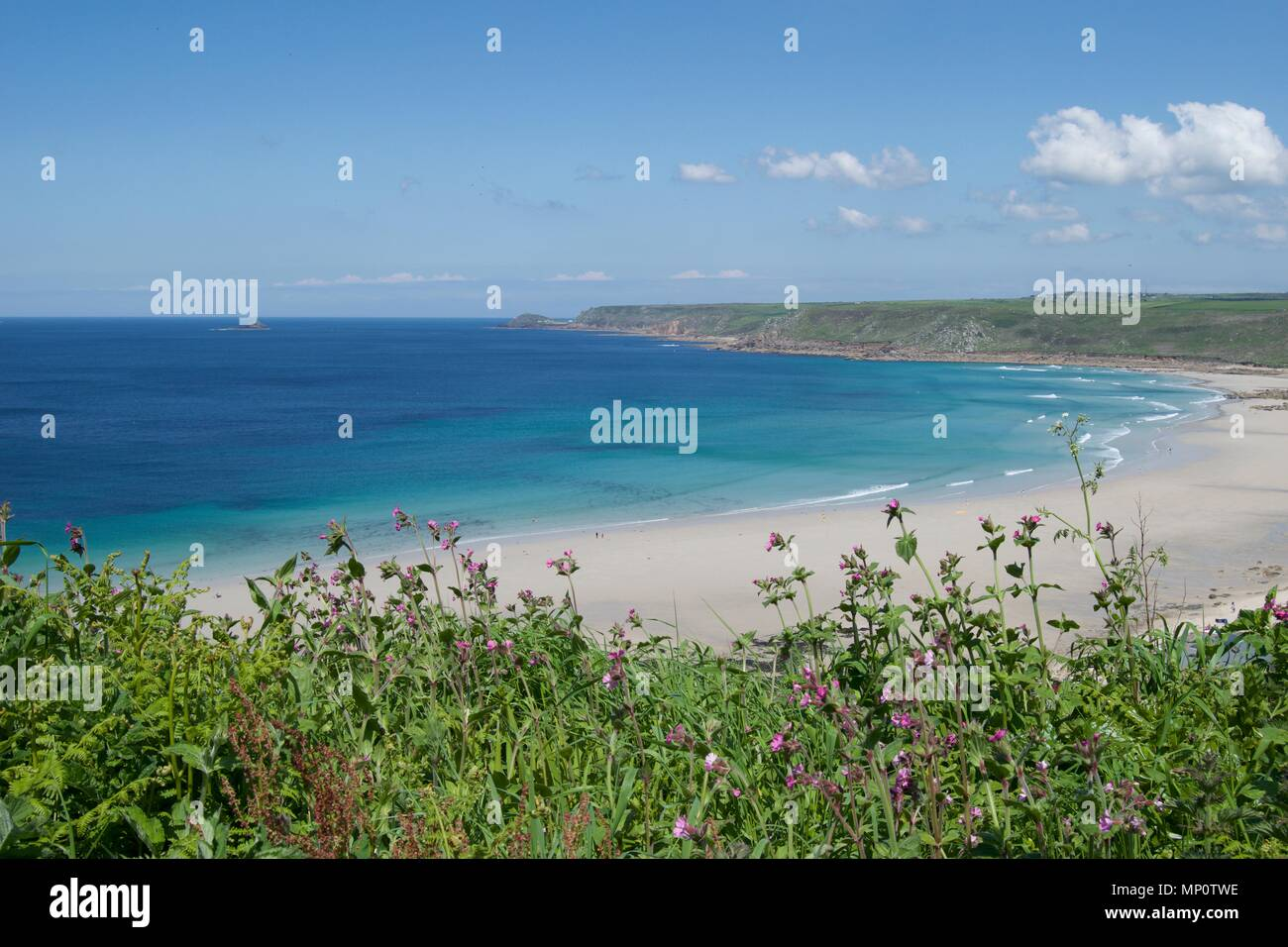 A view over the beautiful white sand beach of Sennen Cove, Cornwall, UK. - Stock Image