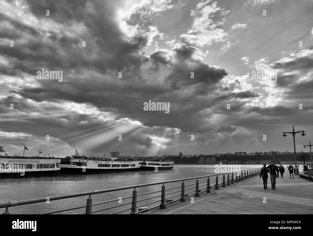 New York City, New York, USA - People walking along the Hudson Park Pier 84. - Stock Image