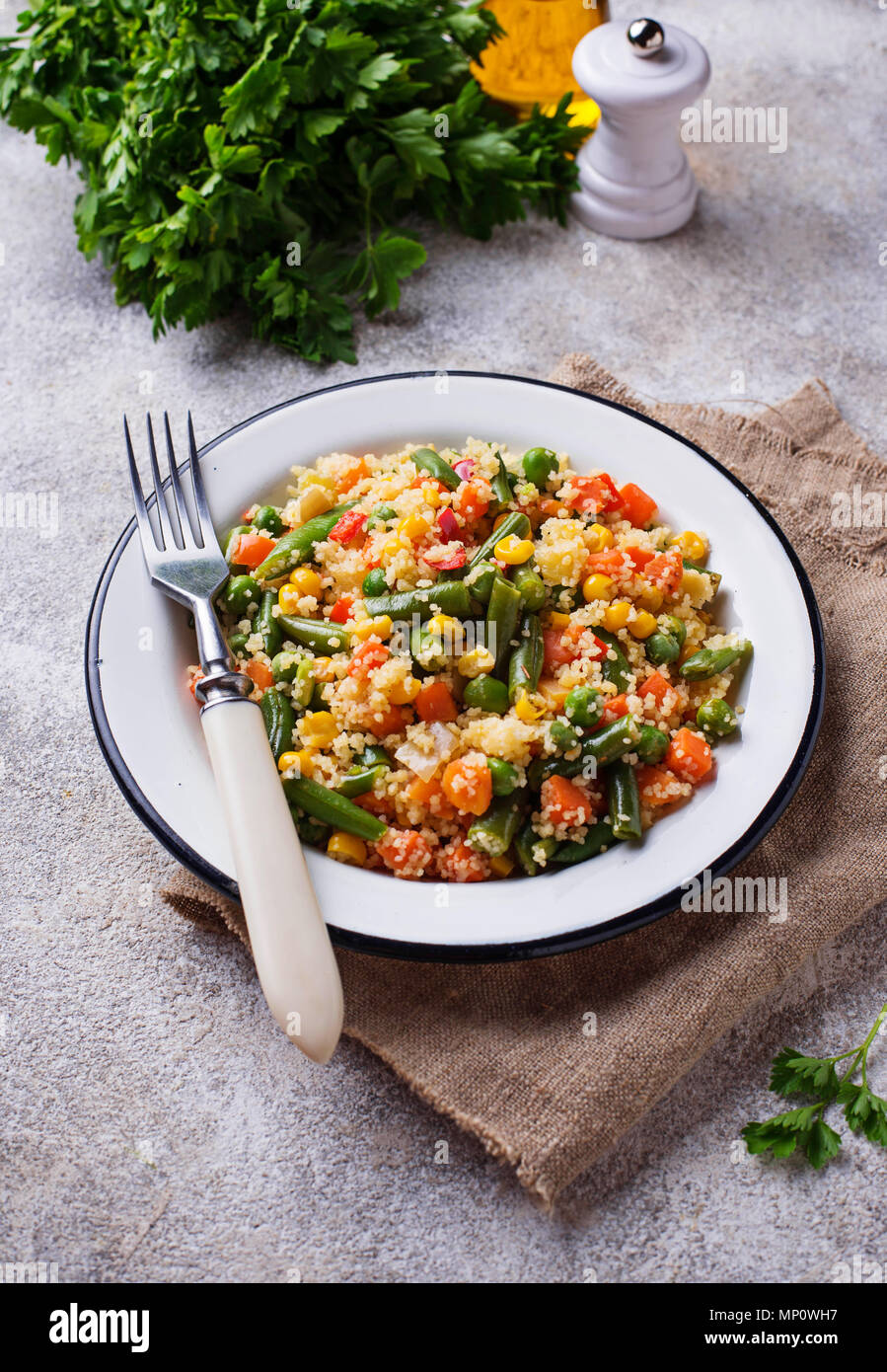 Vegetarian dish couscous with vegetables - Stock Image