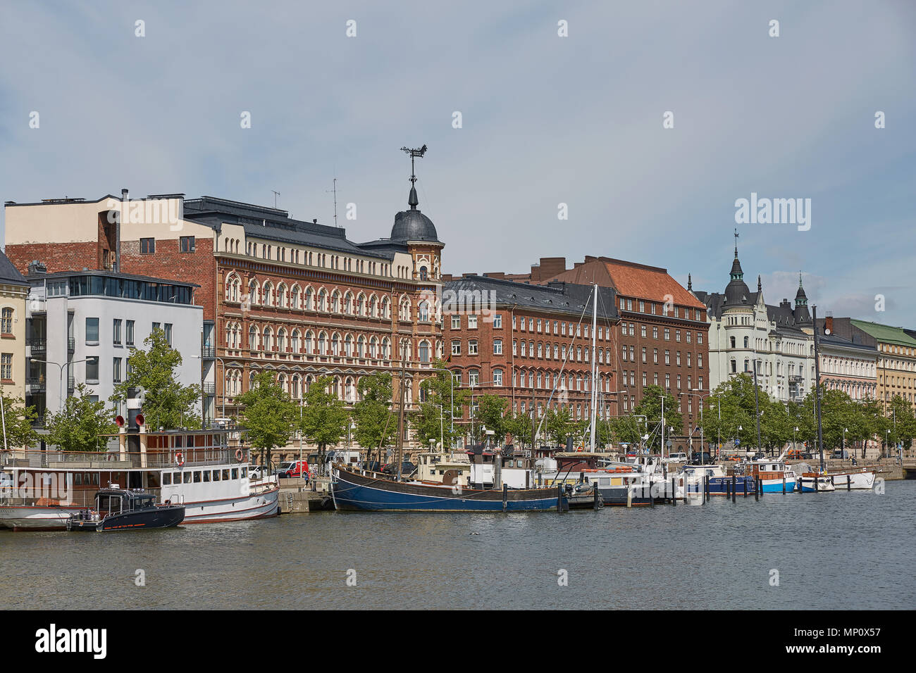 HELSINKI, FINLAND - JULY 10, 2017: Exquisite residences in Helsinki in Finland are along embankment Pohjoisranta. They were built in late 19th and ear - Stock Image