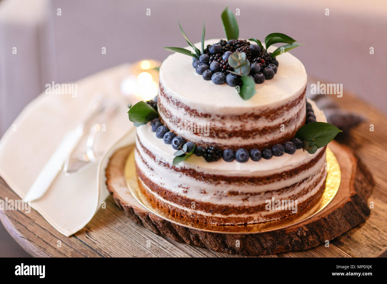 Wedding or birthday cake with berries. Sweet pie on banquet in restaurant. - Stock Image