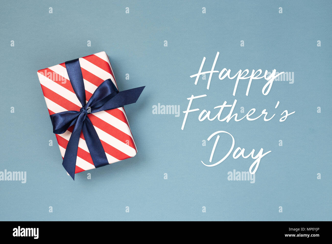 Happy Fathers Day Greeting Card With Decorated Gift Box On Blue