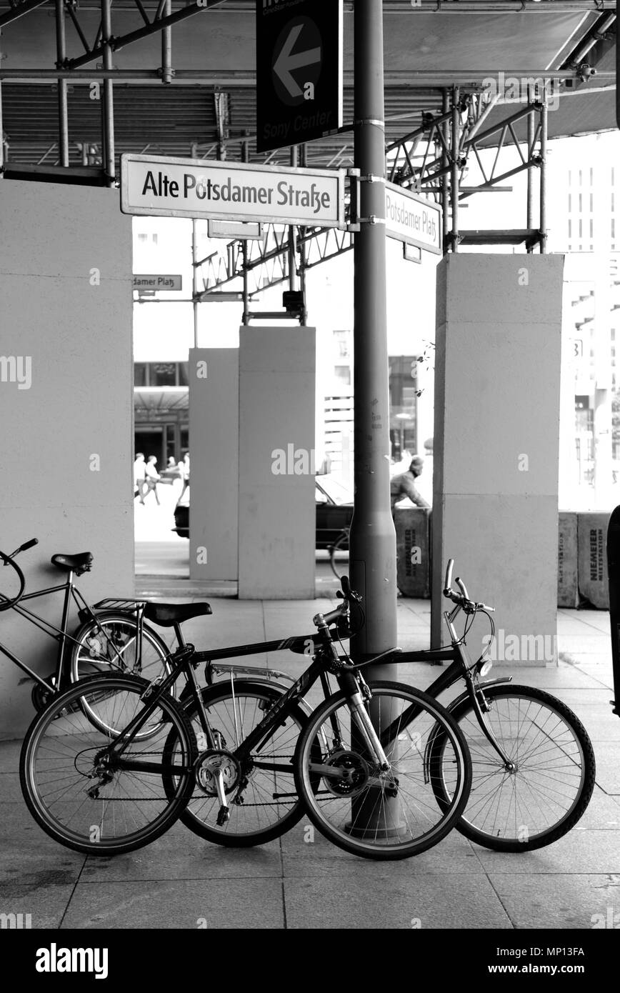 Berlin, GERMANY, Cycles parked on the corner of the 'Alt Potsdamer Strasse' and 'Potsdamer Platz'  Locked to a Lamp-post Tuesday 16/06/2009, - Stock Image