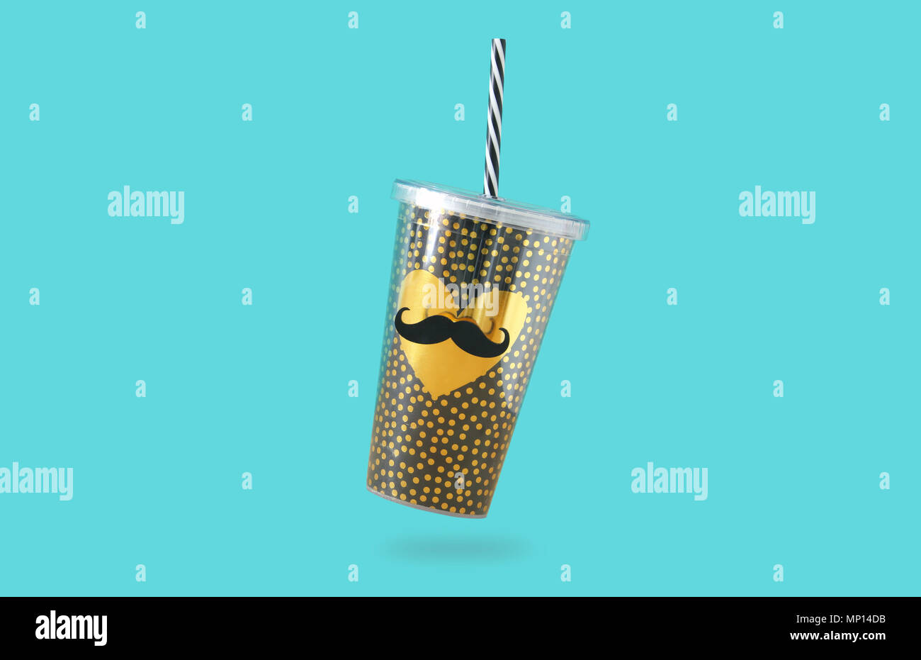 minimalism concept. cute plastic cup with gold heart and mustache decoration for soda or cold beverage with drinking straw. Father's day concept Stock Photo